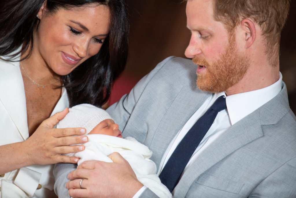 Britain's Prince Harry and Meghan, Duchess of Sussex hold their baby son, who was born on Monday morning, during a photocall in St George's Hall at Windsor Castle, in Berkshire, Britain May 8, 2019. Dominic Lipinski/Pool via Reuters