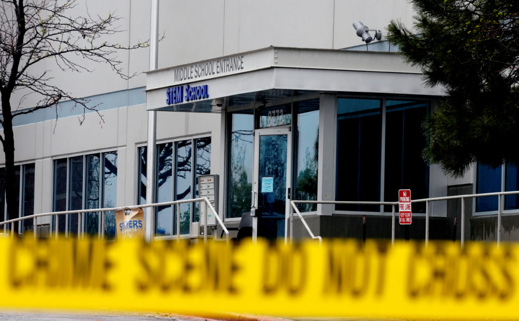 Crime scene tape is seen outside the school following the shooting at the Science, Technology, Engineering and Math (STEM)...
