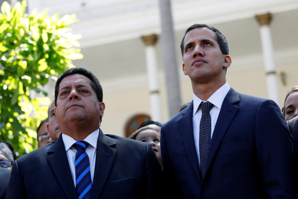 Juan Guaido (right) of the Venezuelan opposition party and lawmaker Edgar Zambrano of Democratic Action party, leave the c...
