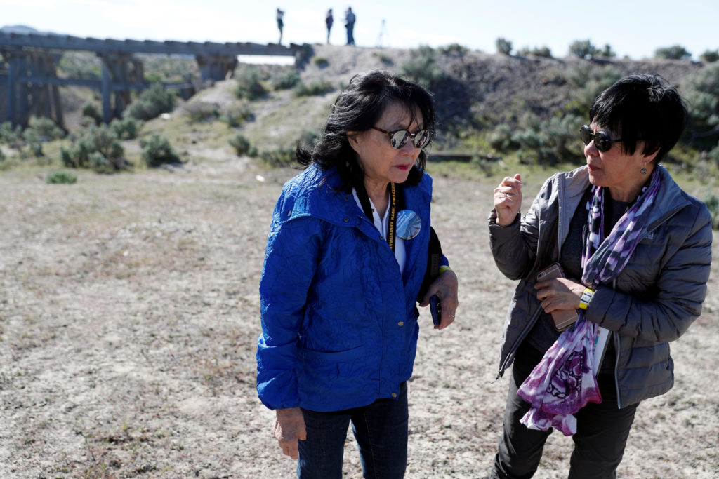 Historian Connie Young Yu (left) talks with Sue Lee, former director of the Chinese Historical Society of America, near a trestle on a historic railroad grade near Kelton, Utah, on May 8, 2019.  Chinese immigrants were integral to building the Transcontinental Railroad, which is celebrating the 150th anniversary of its completion. Photo by Terray Sylvester/Reuters