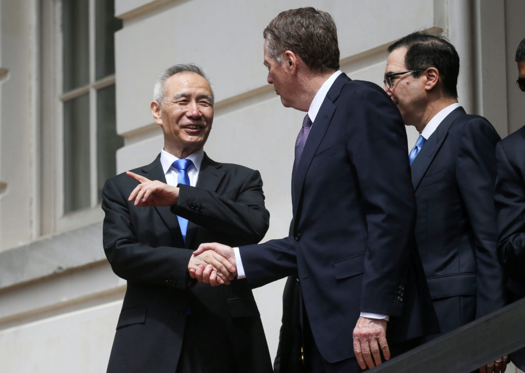 Chinese Vice Premier Liu He talks with U.S. Trade Representative Robert Lighthizer and Treasury Secretary Steven Mnuchin as he departs a round of trade talks in Washington, on May 10, 2019. Photo by Clodagh Kilcoyne/Reuters