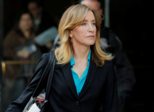 Actor Felicity Huffman, facing charges in a nationwide college admissions cheating scheme, leaves federal court in Boston, Massachusetts, on April 3, 2019. Brian Snyder/Reuters