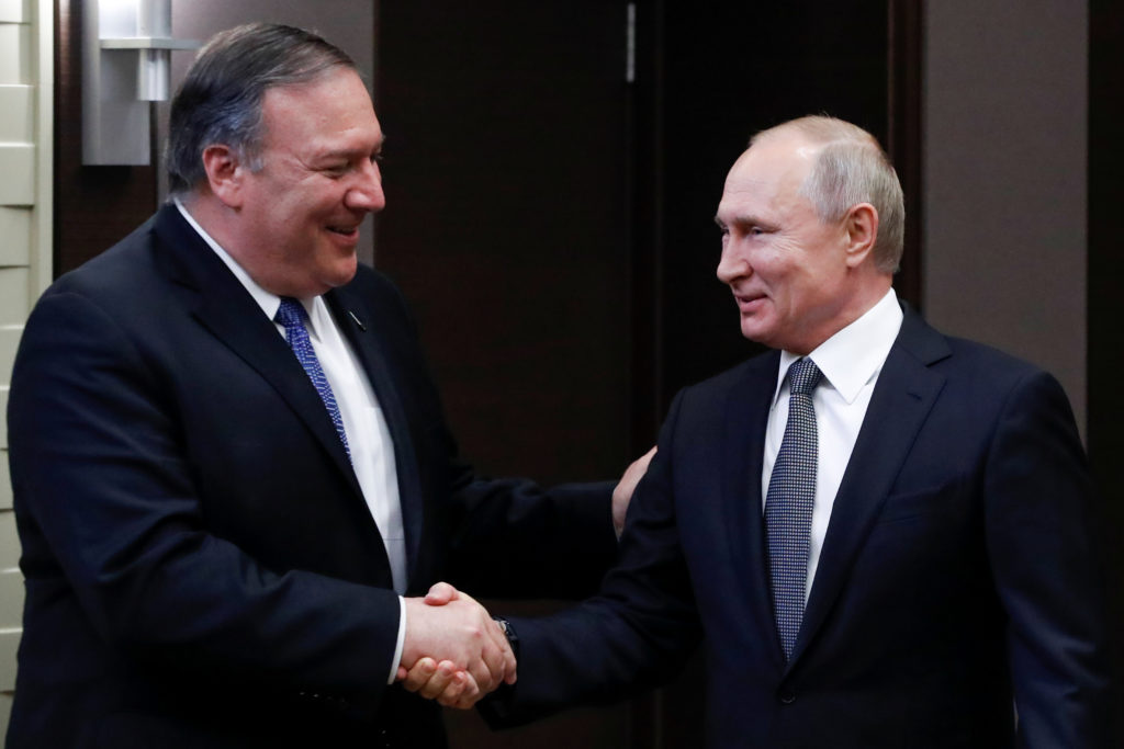 Russian President Vladimir Putin and U.S. Secretary of State Mike Pompeo shake hands prior to their talks in the Black Sea resort city of Sochi, Russia, on May 14, 2019. Photo by Pavel Golovkin/Pool via Reuters