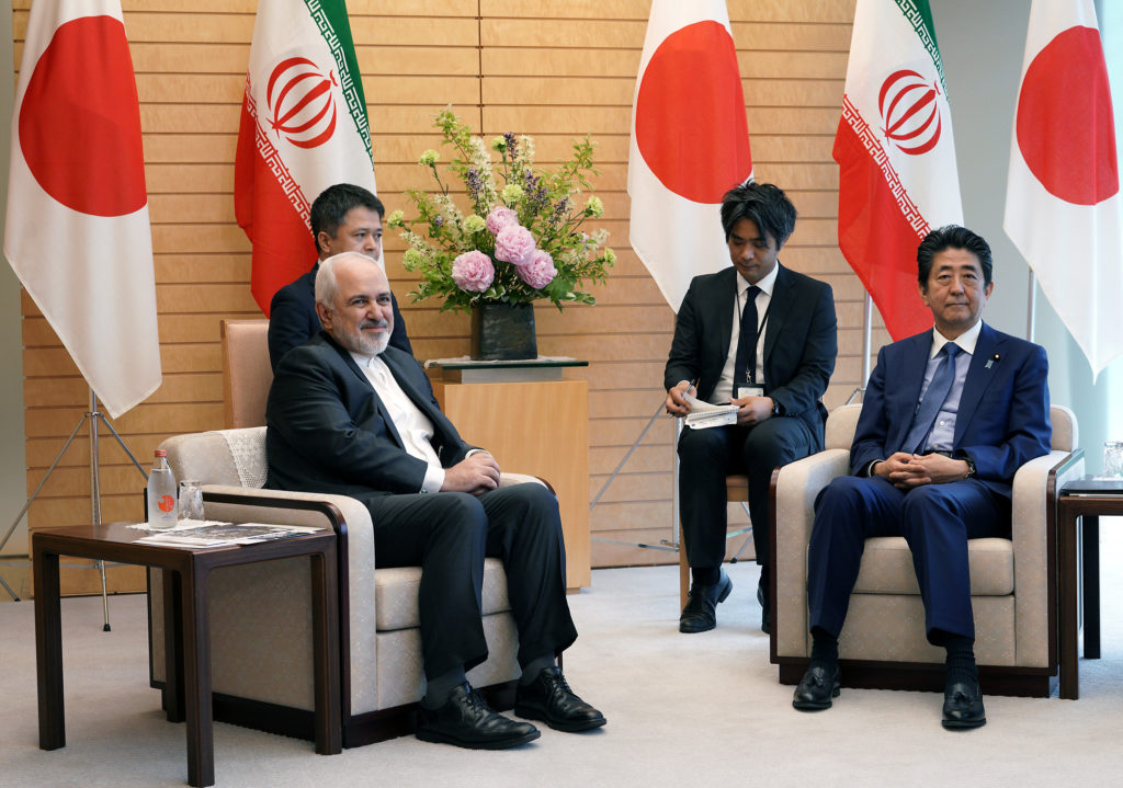 Iranian Foreign Minister Mohammad Javad Zarif, left, and Japanese Prime Minister Shinzo Abe, right, speak at Abe's official residence in Tokyo. Photo by Eugene Hoshiko/Pool via Reuters
