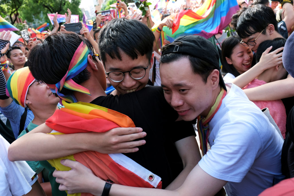 Same-sex marriage supporters celebrate after Taiwan became the first place in Asia to legalize same-sex marriage, outside the Legislative Yuan in Taipei, Taiwan. Photo by Tyrone Siu/Reuters