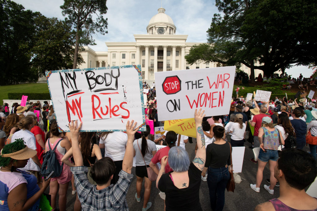 People gather at the Alabama State Capitol during the March for Reproductive Freedom against the state's new abortion law, the Alabama Human Life Protection Act, in Montgomery, Alabama. Photo by Michael Spooneybarger/Reuters