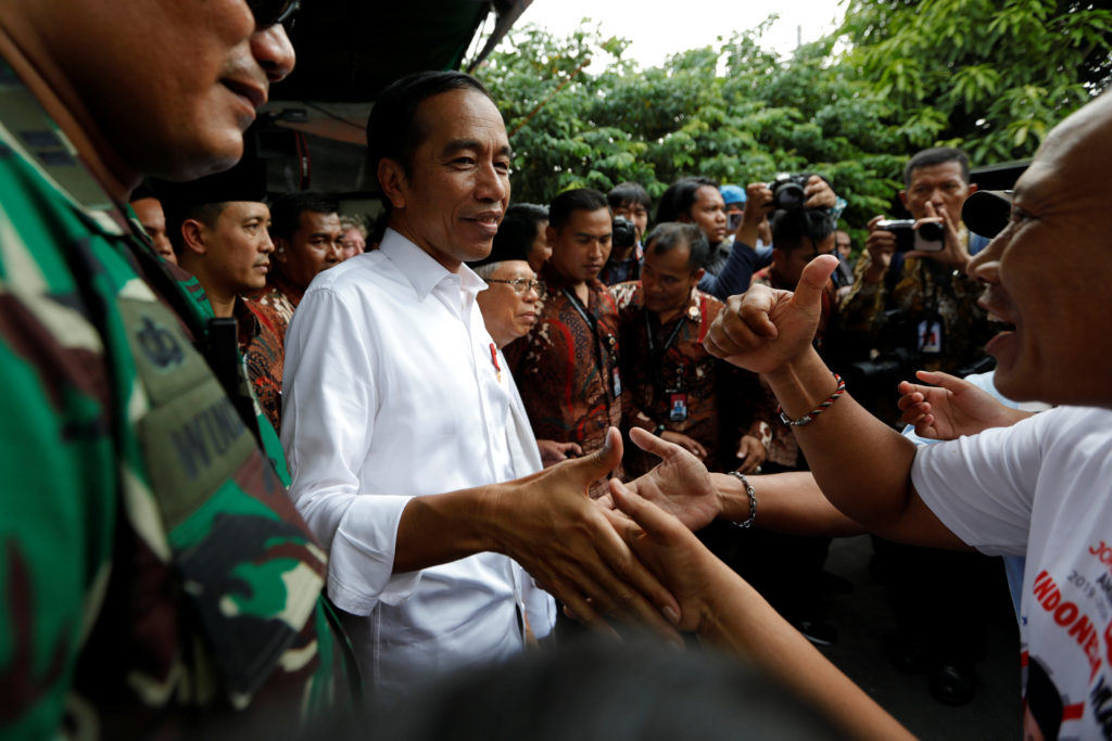 Indonesia's Incumbent President Joko Widodo and his running mate Ma'ruf Amin greet their supporters after making a public address following the announcement of the last month's presidential election results at a rural area of Jakarta, Indonesia, May 21, 2019. Photo by Willy Kurniawan/Reuters