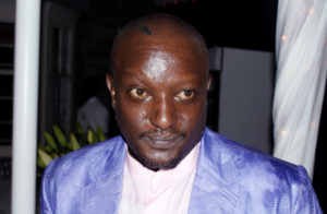 Kenyan writer Binyavanga Wainaina, who challenged stereotypes of Africa with biting satire and took on prejudice by documenting his life as an openly gay man, is seen at his an event in Nairobi, Kenya in this picture taken September 4, 2014. Photo via Reuters