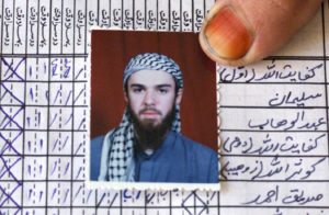 A picture of John Walker Lindh is shown on the attendance register of the madrassa (Islamic school) Arabia Hassani Kalan Surani Bannu, in Bannu in Pakistan, January 26, 2002. Photo by Haider Shah/Reuters File Photo