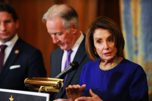 "House Speaker Nancy Pelosi (D-CA) and House Ways and Means Chairman Richard Neal (D-MA) hold a news conference on H.R.2481, the ""Gold Star Family Tax Relief Act"" in Washington, D.C. Photo by Mary F. Calvert/Reuters"
