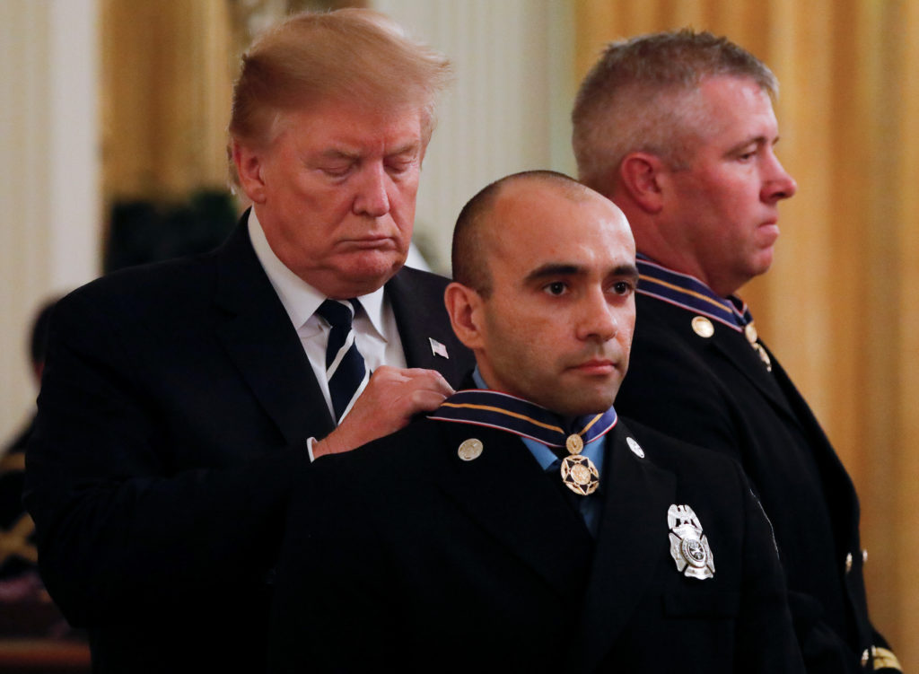 President Donald Trump presents the Public Safety Medal of Valor to one of 14 recipients in the East Room of the White House in Washington, on May 22, 2019. Photo by Carlos Barria/Reuters