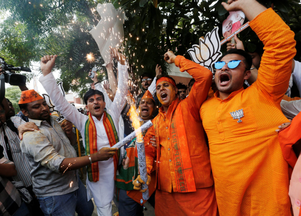 BJP supporters celebrate after learning the initial election results outside the party headquarters in New Delhi, India, on May 23, 2019. Photo by Adnan Abidi/Reuters