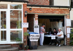 Voters are seen at a polling station for the European elections, taking place despite Brexit uncertainty, at a residential house in South Croydon, Britain, on May 23, 2019. Photo by Hannah Mckay/Reuters
