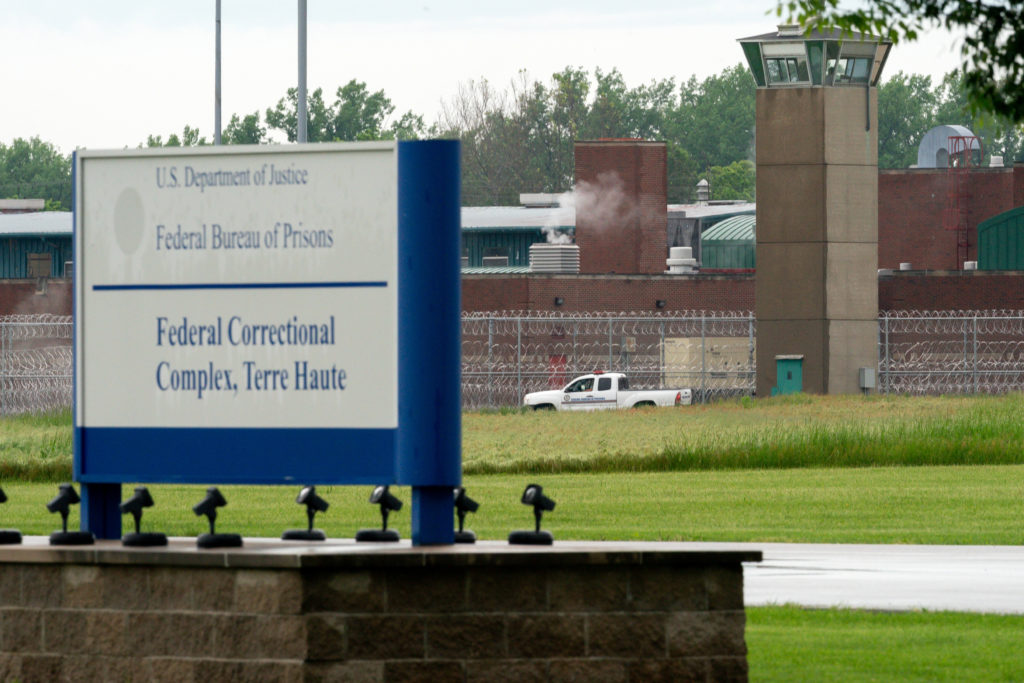 "A vehicle patrols the perimeter of the Federal Correctional Complex where John Walker Lindh, known as the ""American Taliban"" was released early this morning in Terre Haute, Indiana. Photo by Bryan Woolston/Reuters"