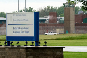 """A vehicle patrols the perimeter of the Federal Correctional Complex where John Walker Lindh, known as the """"American Taliban"""" was released early this morning in Terre Haute, Indiana. Photo by Bryan Woolston/Reuters"""