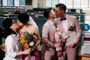 Couples Shane Lin (R) and Marc Yuan, and Cynical Chick (L) and Li Ying-Chien, kiss after registering for same-sex marriage at the Household Registration Office in Shinyi District in Taipei, Taiwan. Photo by Tyrone Siu/Reuters