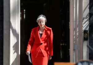 British Prime Minister Theresa May walks out of 10 Downing Street before announcing her resignation. Photo by Simon Dawson/Reuters