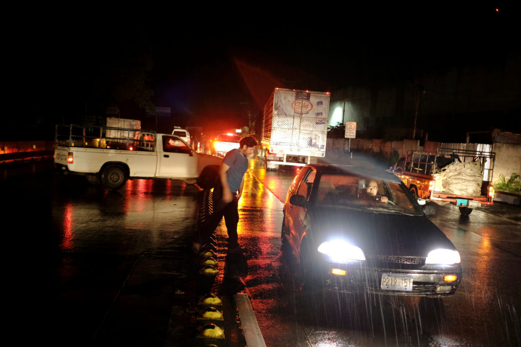 Drivers wait as traffic is stopped after an earthquake on a highway in San Salvador, El Salvador, on May 30, 2019. Photo by Jose Cabezas/Reuters