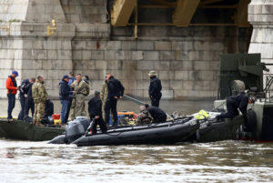 Police special forces officers and divers are seen on boats at the site of a ship accident, which killed several people, near Margaret Bridge on the Danube river in Budapest, Hungary, on May 30, 2019. Photo by Antonio Bronic/Reuters