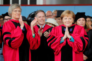 German Chancellor Angela Merkel acknowledges the applause, including from fellow honorary degree recipient Drew Faust (left), as Merkel receives an honorary Doctor of Laws degree during the 368th Commencement Exercises at Harvard University in Cambridge, Massachusetts, on May 30, 2019. Photo by Brian Snyder/Reuters