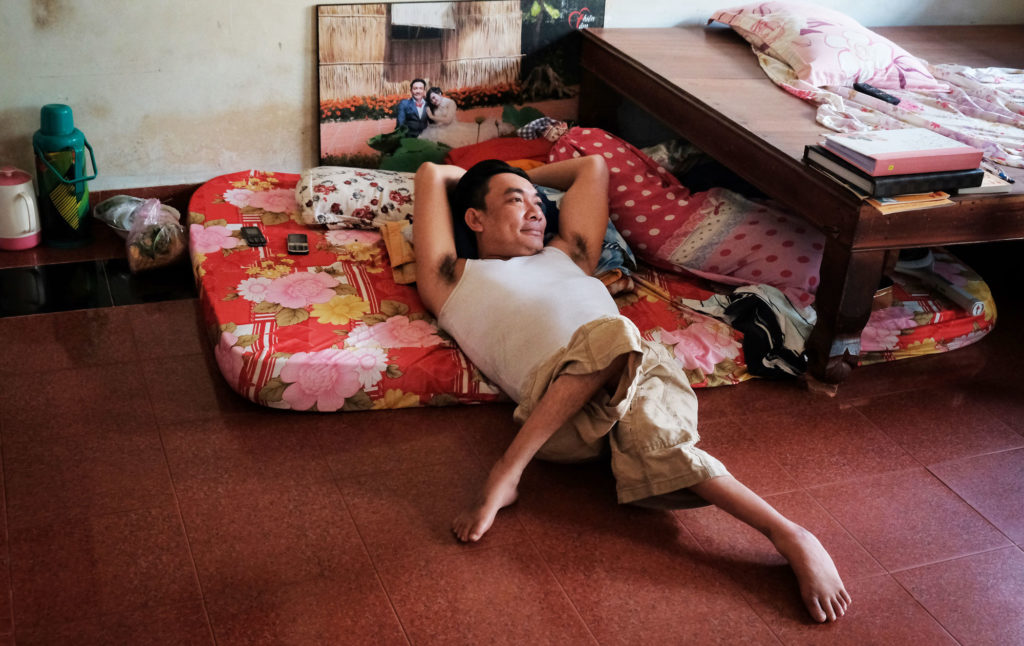 Nguyen Kien, 40, whose legs were deformed by exposure to dioxin, at his home in Trung Dung, just south of the Bien Hoa air base. Photo by Cuong Tran/FERN