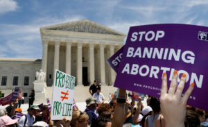 FILE PHOTO: Abortion rights activists rally outside the U.S. Supreme Court in Washington, U.S., May 21, 2019. REUTERS/Kevin Lamarque/File Photo