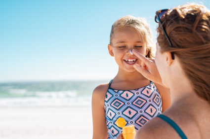 The FDA recommends a school-aged child on a beach vacation should use up at least an 8 ounce bottle of commercial broad-spectrum sunscreen over the course of a week. Image by Rido/Adobe