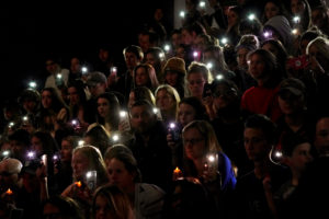 People hold up the phone lights during a moment of silence at a vigil for the victims of the shooting at the Science, Technology, Engineering and Math (STEM) School in Highlands Ranch, Colorado, U.S., May 8, 2019 as U.S. Sen. Michael Bennett (D-Co.) speaks. Photo by Rick Wilking/Reuters