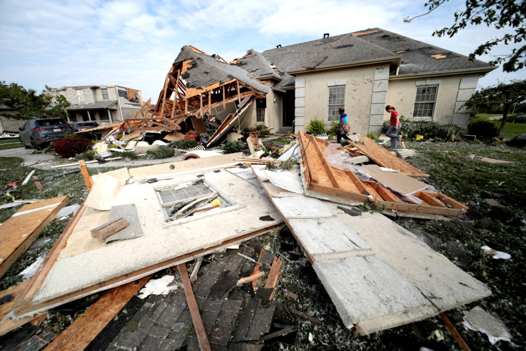 Neighbors in Clayton, Ohio gather belongings after houses were damaged after a tornado touched down overnight near Dayton, Ohio, U.S. May 28, 2019. REUTERS/Kyle Grillot