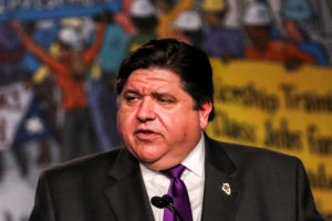 llinois Governor J.B. Pritzker delivers remarks at the North America's Building Trades Unions (NABTU) 2019 legislative conference in Washington, U.S., April 9, 2019. Photo by Jeenah Moon/Reuters