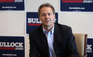 Montana Governor Steve Bullock talks to the media as he launches a 2020 U.S. presidential campaign in Helena, Montana, U.S., May 14, 2019. REUTERS/Jim Urquhart - RC13259D90E0