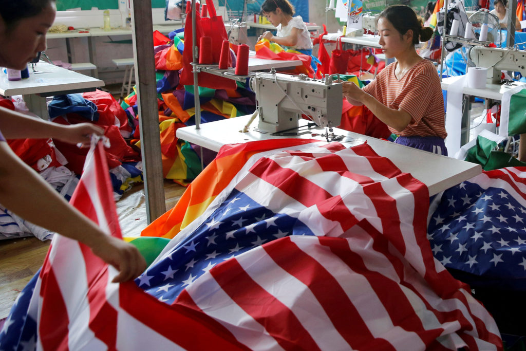 A worker makes U.S. national flags at Jiahao flag factory in Fuyang, Anhui province, China July 24, 2018.  Photo by Aly Song/Reuters