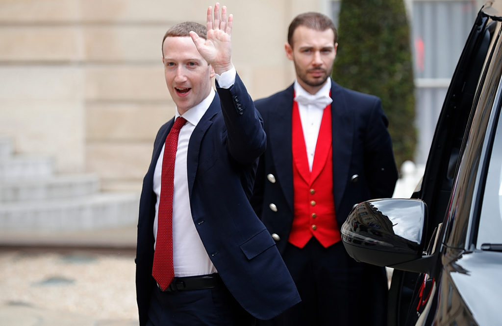 Facebook's CEO Mark Zuckerberg waves as he arrives for a meeting with French President Emmanuel Macron at the Elysee Palace in Paris, France, on May 10, 2019. Photo by Charles Platiau/Reuters