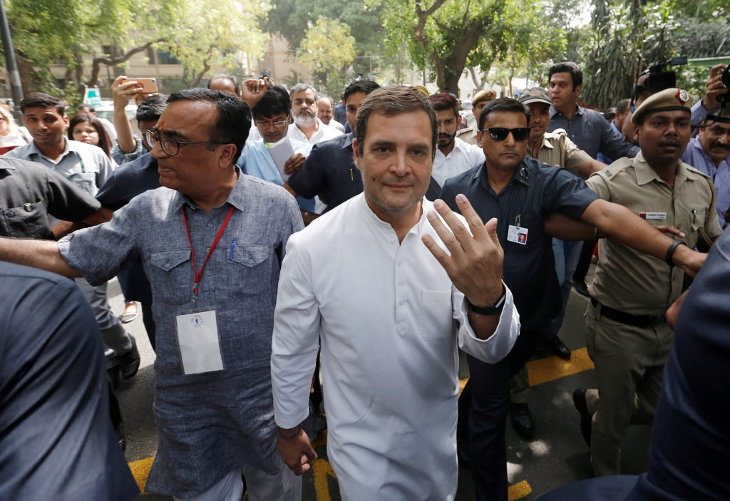 Rahul Gandhi, president of India's main opposition Congress party, shows his ink-marked finger after casting his vote at a polling station in New Delhi, India, May 12, 2019. Photo by Adnan Abidi/Reuters