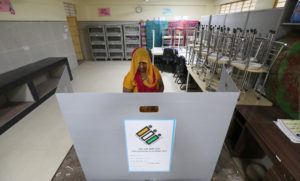 A woman casts her vote at a polling station during the sixth phase of the general election, in New Delhi, India, May 12, 2019. Photo by Anushree Fadnavis/Reuters