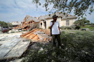 Daniel Williams, of Clayton, Ohio walks through his damaged property after a tornado touched down overnight near Dayton, Ohio, on May 28, 2019. Photo by Kyle Grillot/Reuters