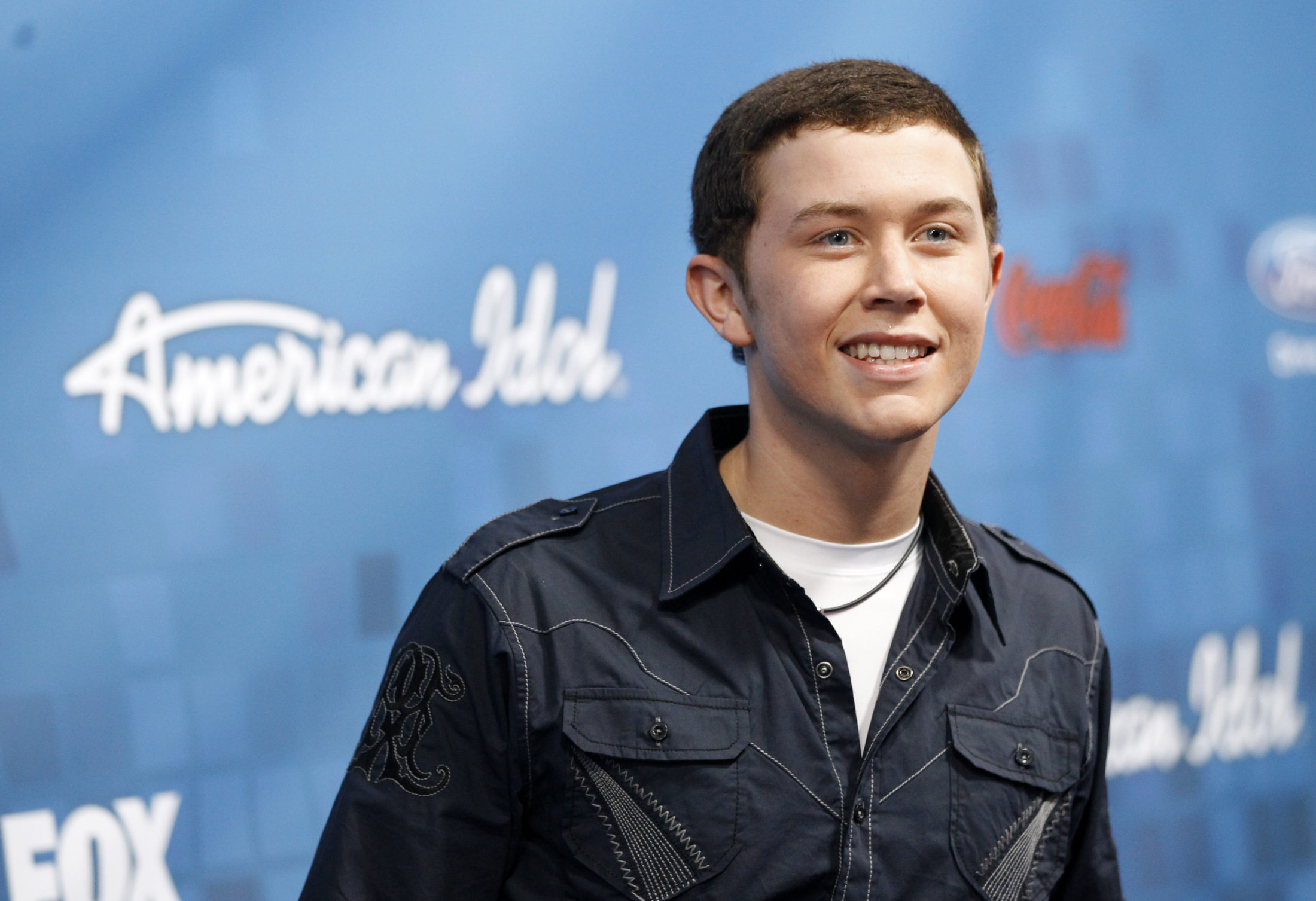 "Performer Scotty McCreery poses at a 2011 party for the finalists of the television show ""American Idol"" in Los Angeles. Photo by Mario Anzuoni/Reuters"