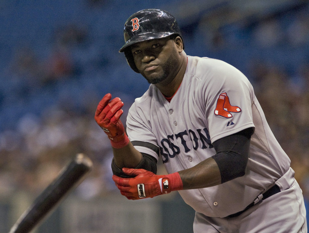 Boston Red Sox designated hitter David Ortiz flips his bat after he was walked by Tampa Bay Rays' Jeremy Hellickson during the first inning of their MLB American League baseball game in St. Petersburg, Florida, September 12, 2013. Photo by REUTERS/Steve Nesius