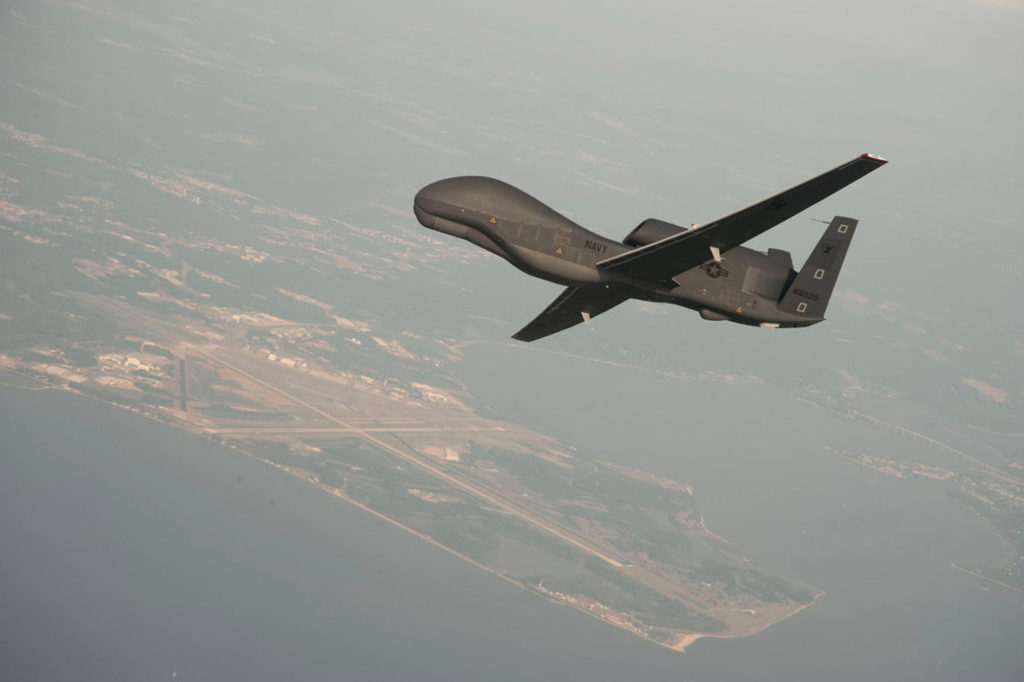 A RQ-4 Global Hawk drone is conducting tests over Naval Air Station…