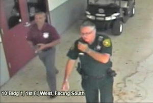Then-Broward County Sheriff's Deputy Scot Peterson, who was assigned to Marjory Stoneman Douglas High School during the February 14, 2018 shooting, is seen in this still image captured from the school surveillance video released by Broward County Sheriff's Office in Florida, U.S. on March 15, 2018. Broward County Sheriff's Office/Handout via Reuters