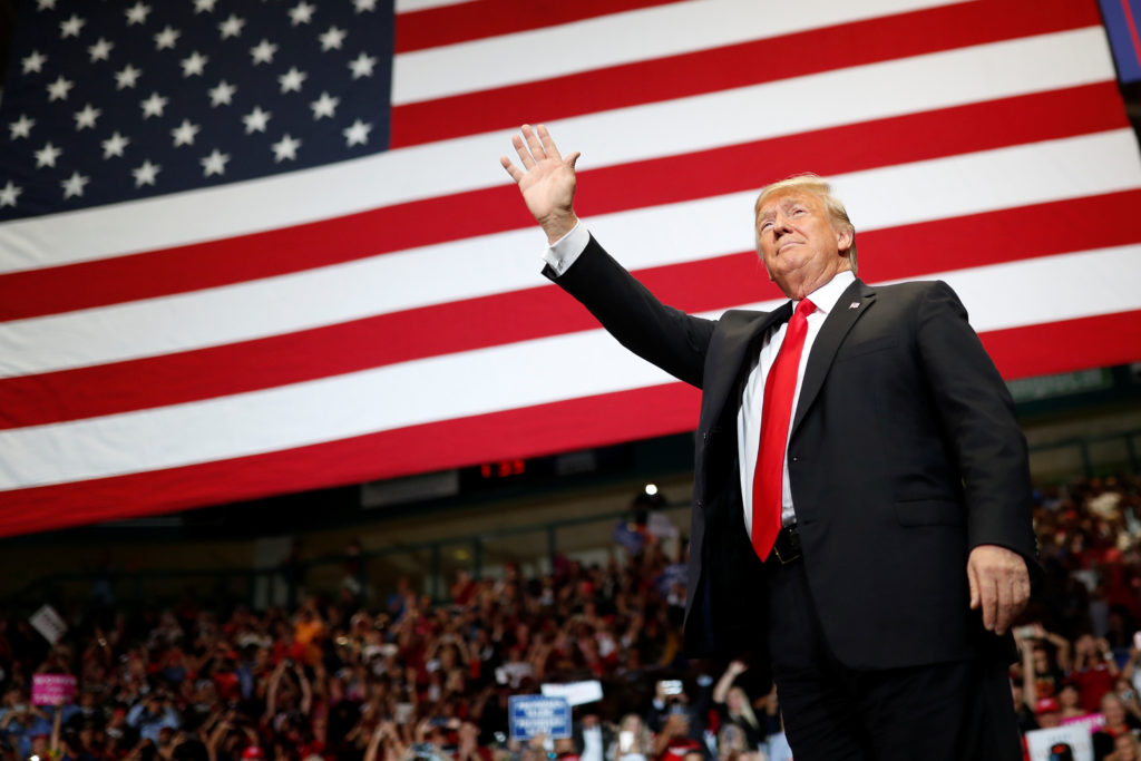 President Donald Trump acknowledges supporters as he holds a campaign rally in Estero, Florida, on October 31, 2018. Photo by Carlos Barria/Reutersa