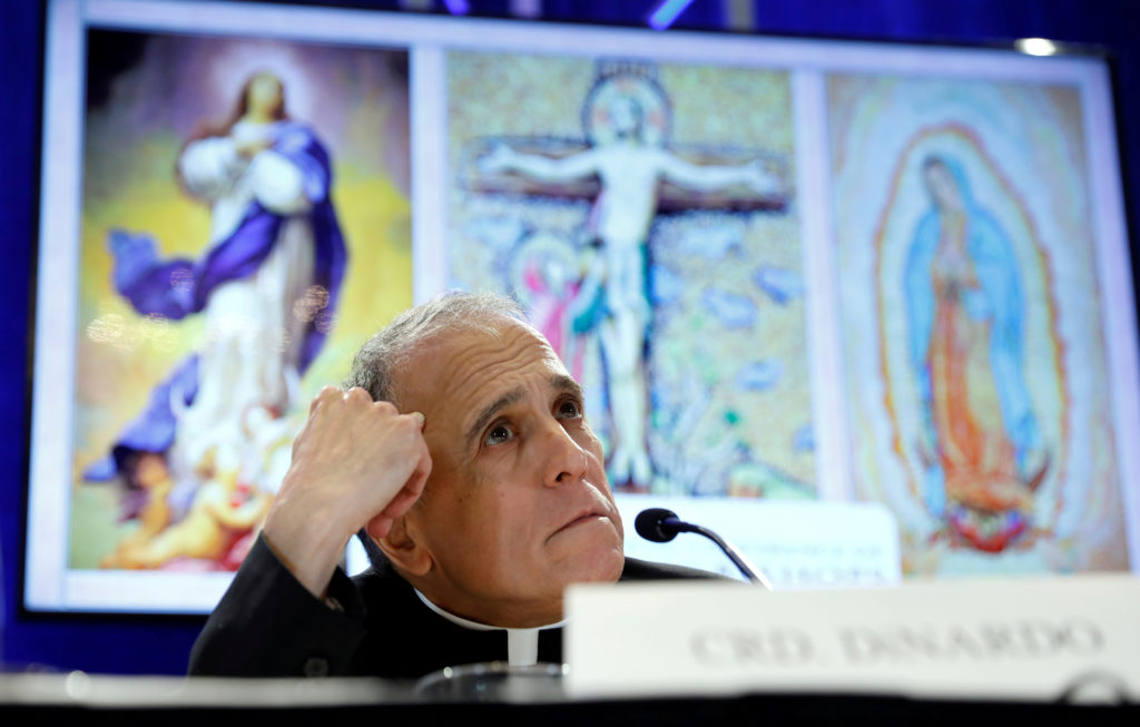 Cardinal Daniel DiNardo, president of the U.S. Conference of Catholic Bishops, looks up while holding a news conference at the USCCB general assembly in Baltimore, Maryland, November 12, 2018.  Photo by Kevin Lamarque/Reuters