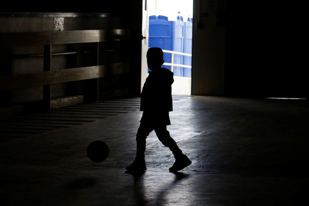 "A child from Central America plays inside the ""House of the Refugee"", which gives temporary shelter to migrants released by ICE and U.S. Customs and Border Protection (CBP) due to overcrowded facilities, in El Paso, Texas, on April 24, 2019. Photo by Jose Luis Gonzalez/Reuters"