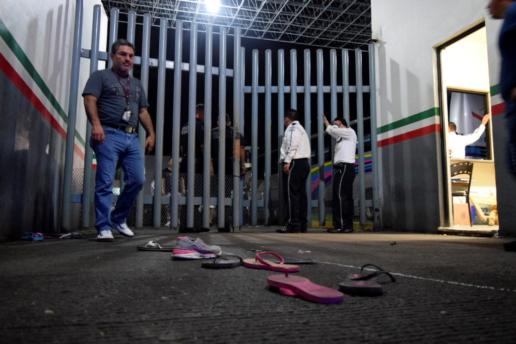 Private security guards are seen at the gate of the Siglo XXI immigrant detention center after a large group of Cubans, Haitians and Central Americans broke out and escaped the facilities, in Tapachula, Mexico, April 25, 2019. Photo by Jose Torres/Reuters