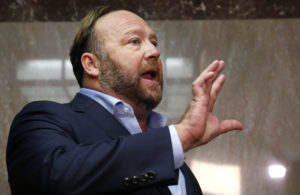 Alex Jones of Infowars talks to the media while visiting the U.S. Senate's Dirksen Senate office building as Twitter CEO Jack Dorsey testifies before a Senate Intelligence Committee hearing on Capitol Hill in Washington, D.C. in 2018. Photo by Jim Bourg/Reuters
