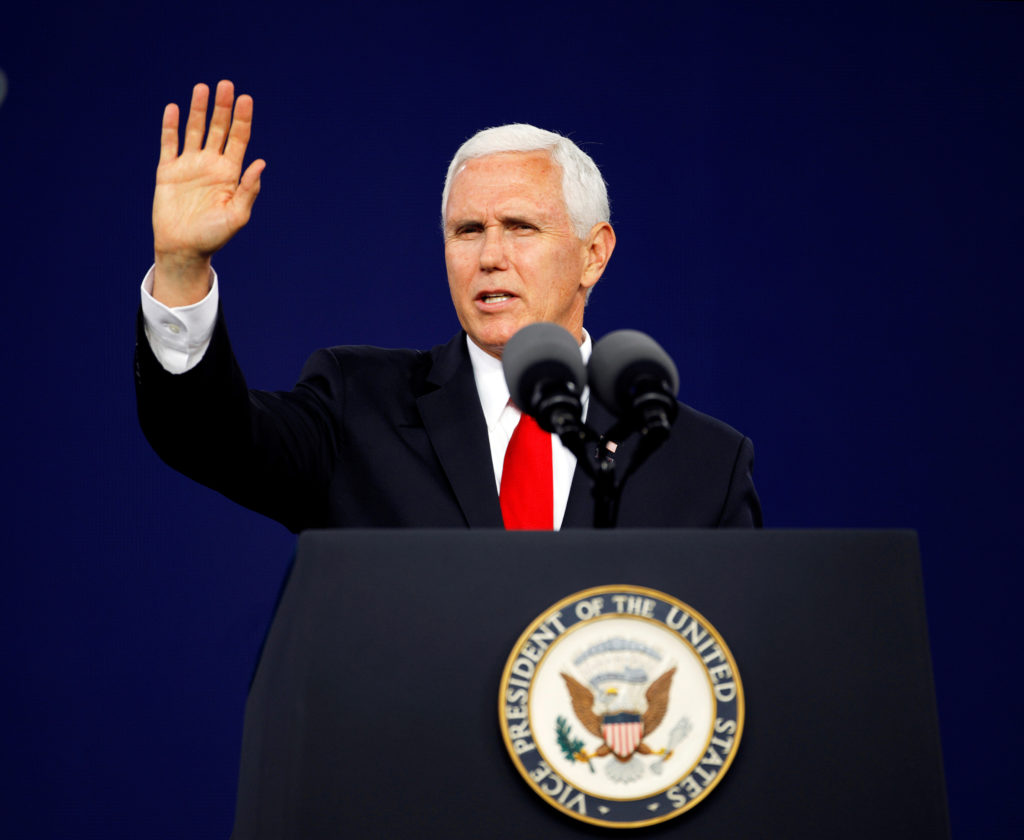 Vice President Mike Pence waves to the audience at the end of his c…