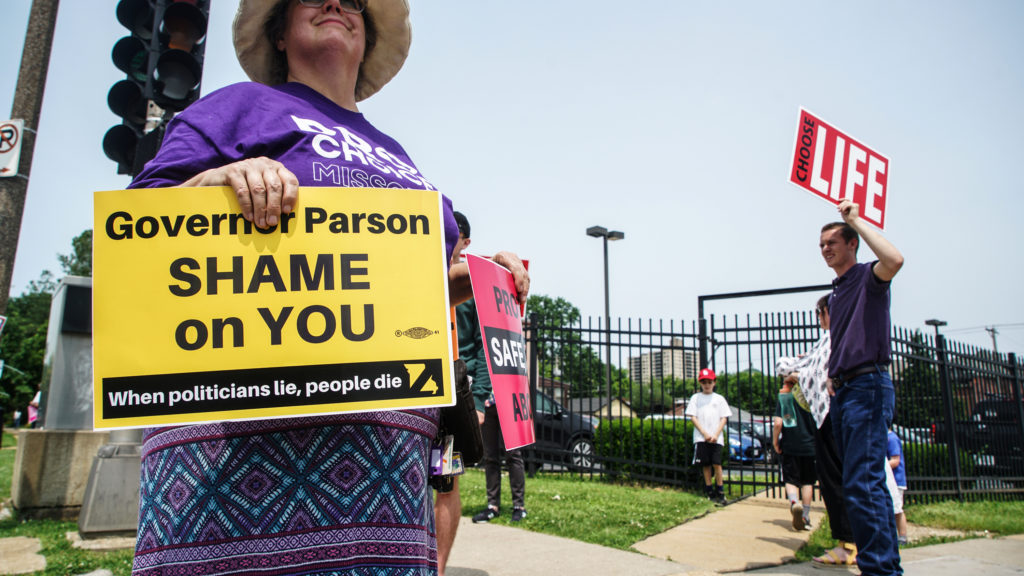 Abortion rights and anti-abortion demonstrators protest outside of Planned Parenthood as a deadline looms to renew the lic...