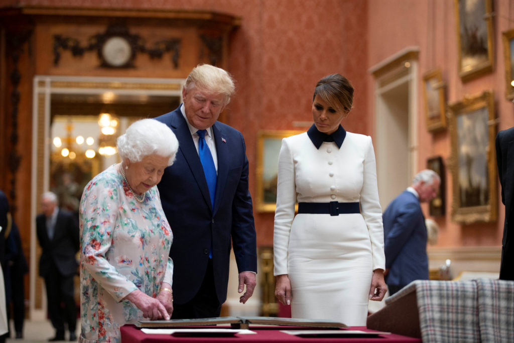 Britain's Queen Elizabeth II looks at a display of U.S. items of the Royal collection with U.S. President Donald Trump and First Lady Melania Trump at Buckingham palace in London, Britain June 3, 2019. Ian Vogler/Pool via Reuters