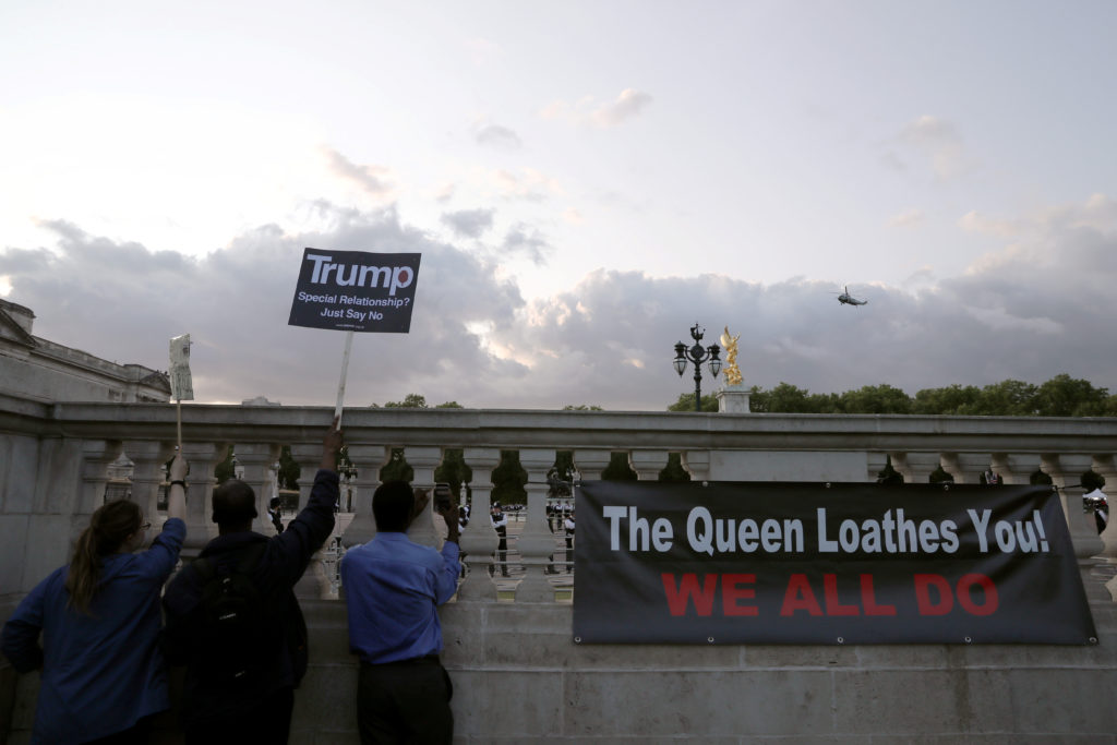 People protest as Marine One is seen outside Buckingham Palace during the state visit of U.S. President Donald Trump and First Lady Melania Trump to Britain, in London, June 3, 2019. Photo by Alkis Konstantinidis/Reuters