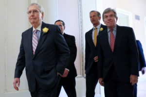 U.S. Senate Majority Leader Mitch McConnell (R-KY), flanked by Senator John Thune (R-SD) and Senator Roy Blunt (R-MO), walks out to talk to reporters after the weekly Republican Party caucus lunch meeting at the U.S. Capitol in Washington, U.S. June 4, 2019. Photo by Jonathan Ernst/Reuters